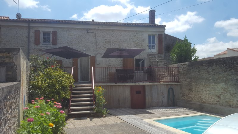 Front of house with pool and terrace