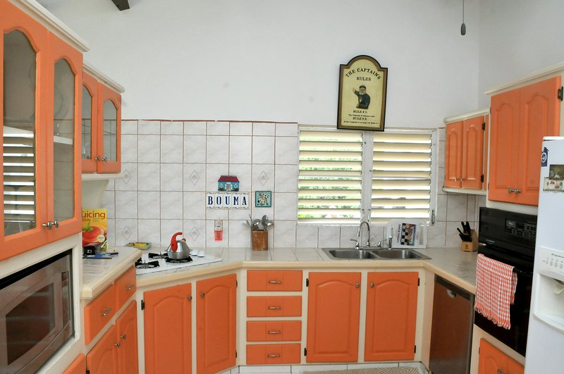 Full size kitchen with double oven dishwasher and microwave