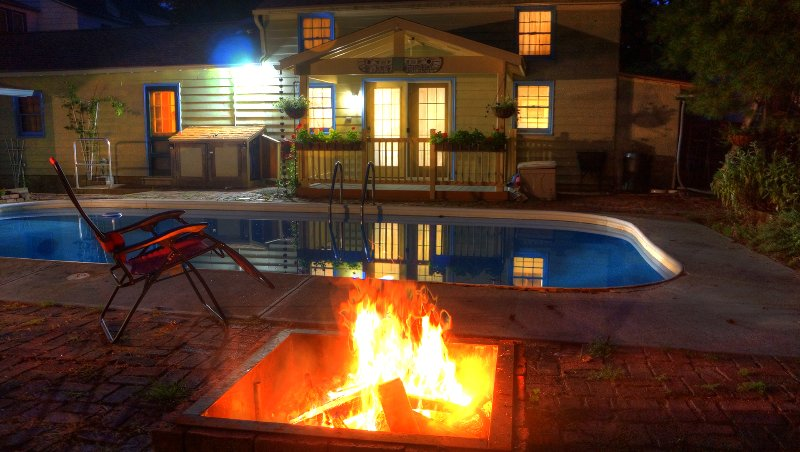 The Pool House viewed across the pool from the fire pit