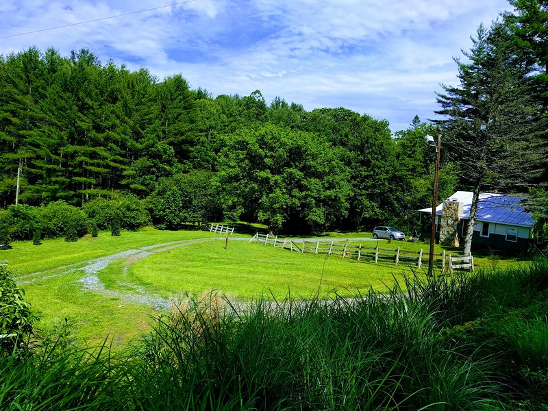 Formerly was a horse pasture. Relax, swim, play, or listen to the sound of babbling river