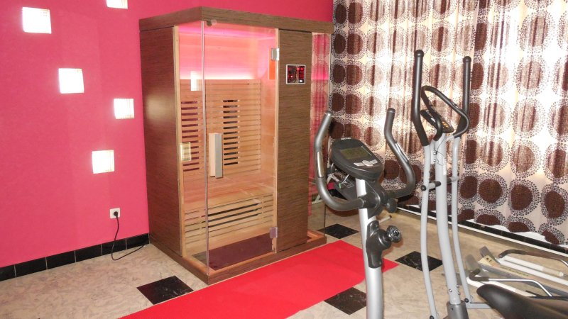 Luxurious infrared cabin with luminotherapy in wellness room.