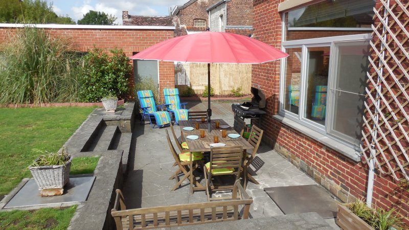 Terrace with garden furniture and gas grill