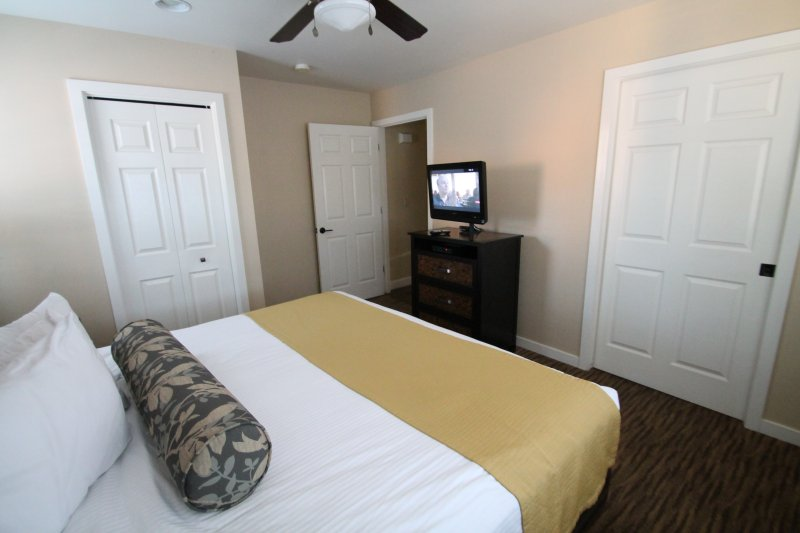 Master bedroom with flat screen TV, and bathroom attached.