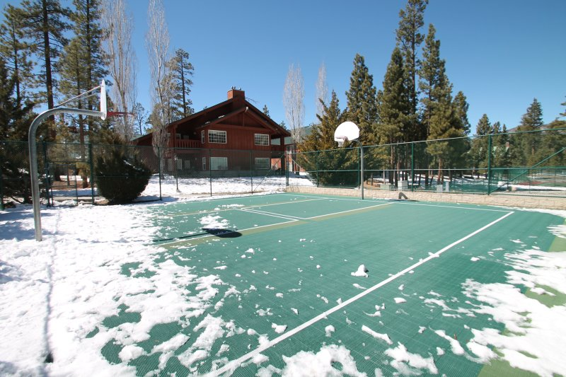 View of building with tennis and basket ball courts.