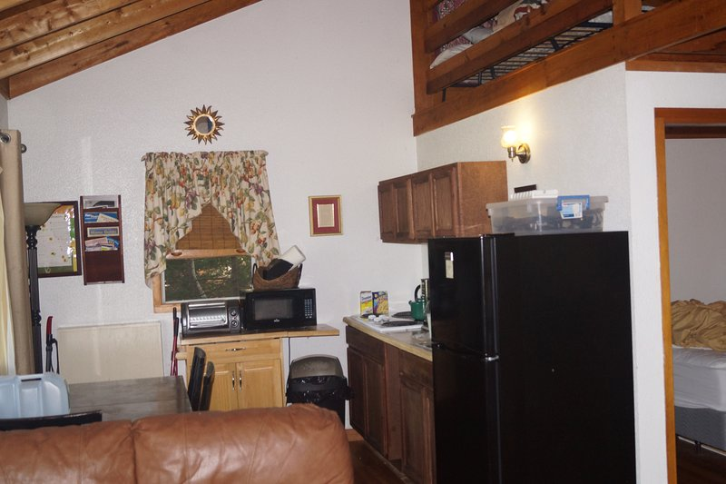 kitchen: toaster oven, microwave, stove top, fridge, coffee maker