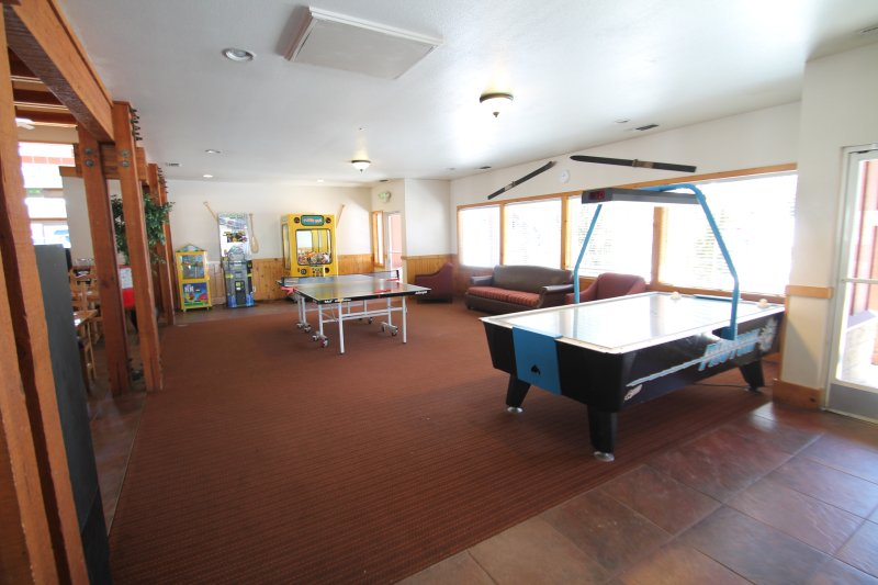 Game area with hockey table and ping pong table.