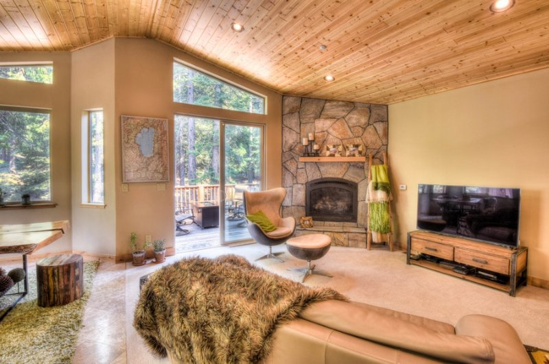 Chic living room with gas fireplace and large, flat screen TV.