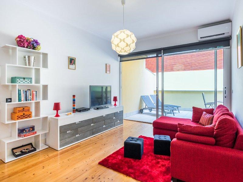 Sala de estar y terraza privada