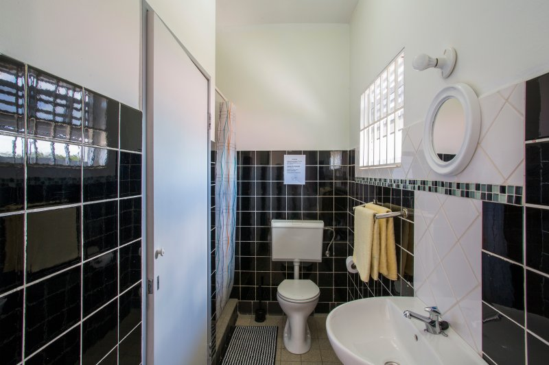 Bathroom with shower, sink and toilet