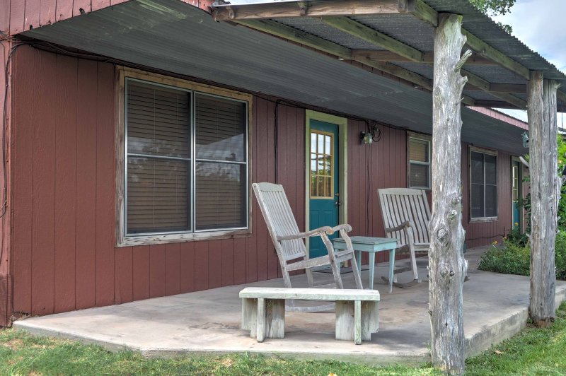 Sit on the covered front porch of the 'Texas Room,' a studio vacation rental in Carmine, and enjoy the fresh Texas air!