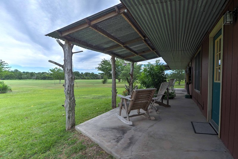 Enjoy the views of the 60-acre farm from the covered porch during your stay at the 'Arizona Room,' a vacation rental studio in Carmine.