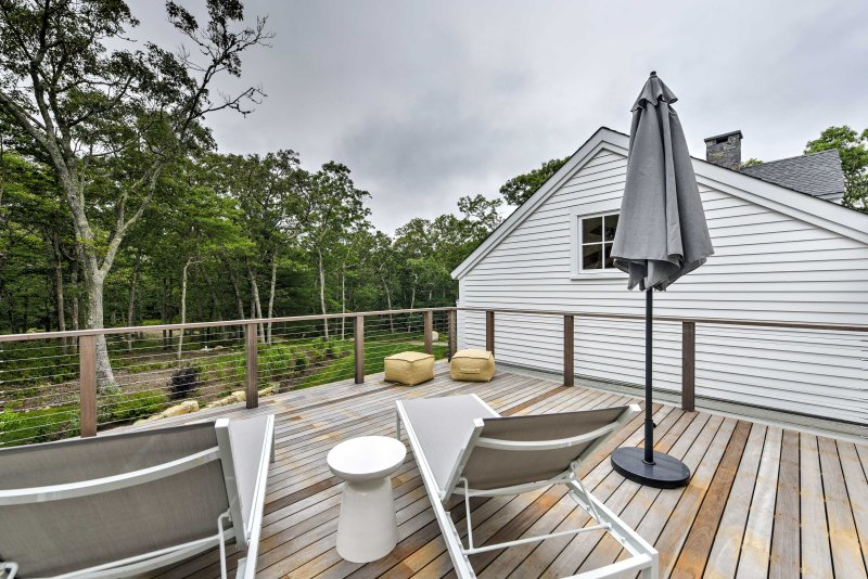 Situated on 3+ private acres with uninterrupted views of the surrounding wilderness, you'll love lounging on the spacious hardwood sun deck!
