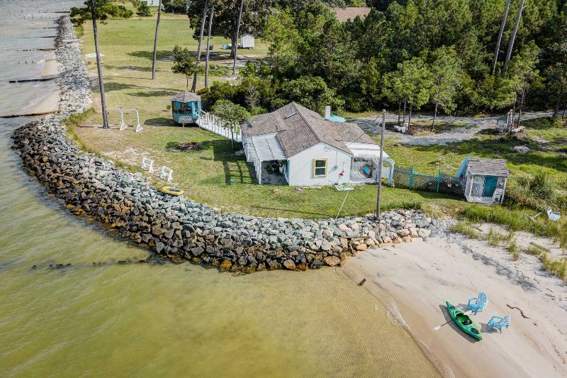 Retreat to the beautiful Virginia coast by staying at this 2-bedroom, 1-bathroom vacation rental cottage in White Stone!