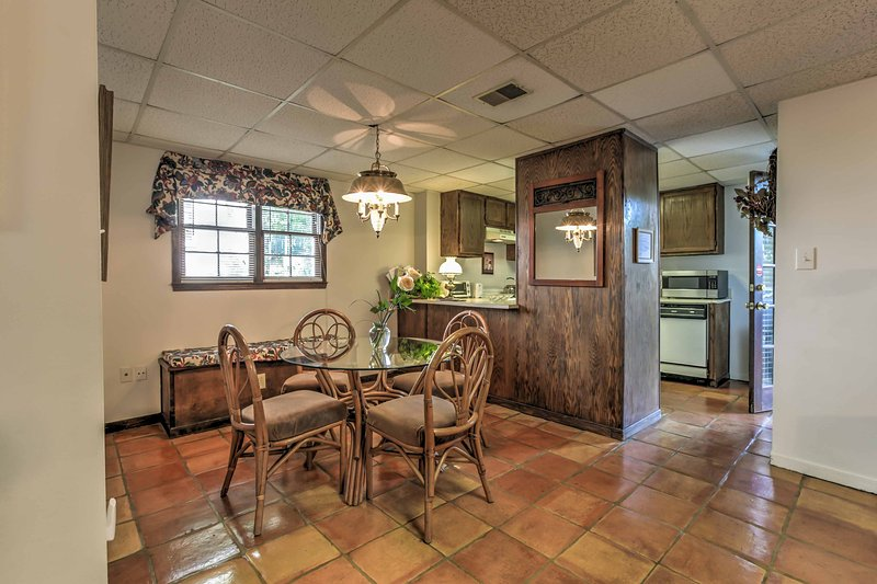 The home features tasteful decor, gorgeous red tiling, and natural wood accents!