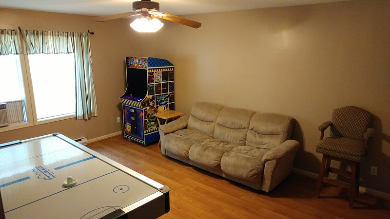 Game room with Air Hockey Table, Multi Arcade game with 48 of the games, Couch & TV