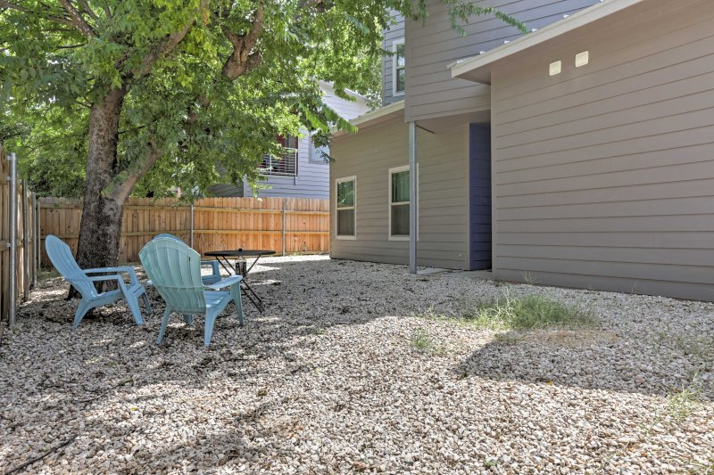 The home has a fenced-in backyard where you can sit back and soak up the sun.