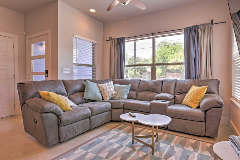 Kick back and relax on the comfy L-shaped couch in the living area.
