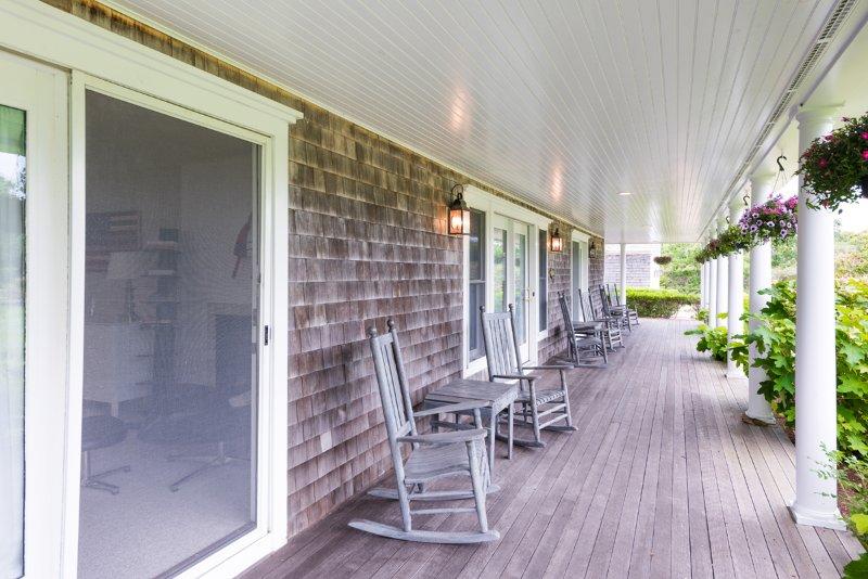 Shady Porch Overlooks Yard