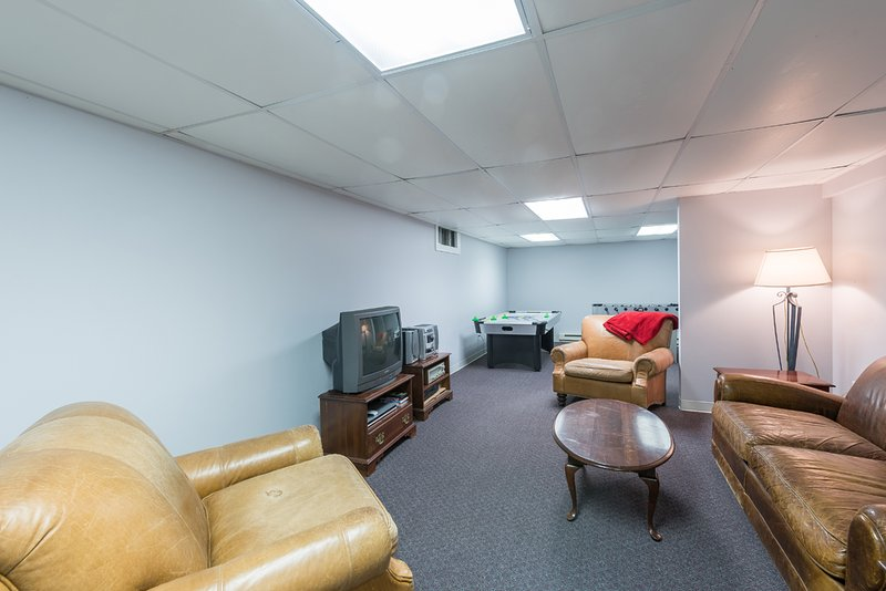 Lower Level TV Room with Game Table, new flat screen TV (no stereo)