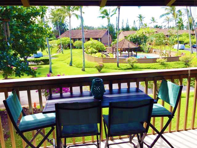 lanai with dining table overlooks just 1 of 3 pools onsite
