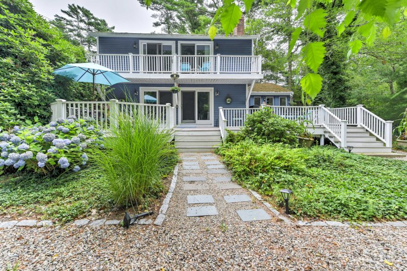 Bike or drive to South Cape Beach and New Seabury, where you can enjoy the ocean and beautiful Waquoit Bay when you stay at this 4-bedroom, 2.5-bathroom vacation rental house!