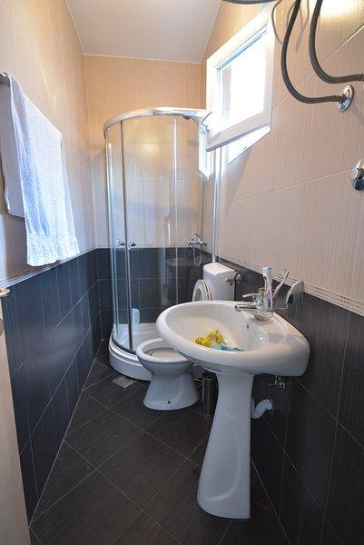 Superior Apartamento banho com chuveiro.
