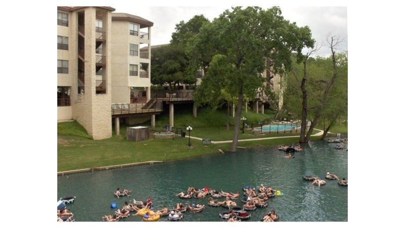 This condo is nestled among beautiful trees overlooking the Comal River!