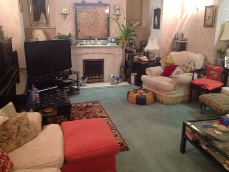 Discoveries House Dorset ground floor Living room with overstrung Yamaha piano
