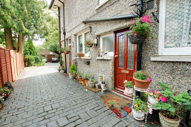Driveway to the house with offroad parking & a half acre garden