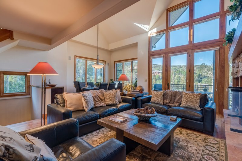 Enjoy a wall of windows adjacent to your living space, welcoming natural sunlight and mountain views right in!