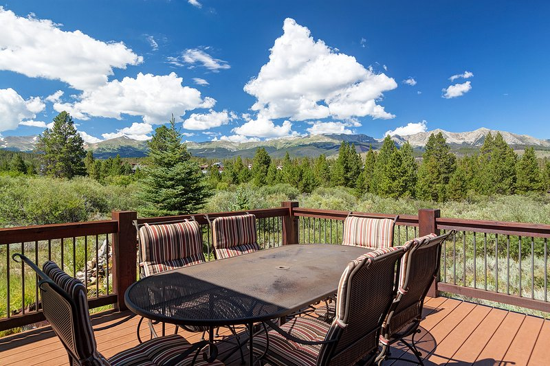Plenty of seating on the upper level deck with mountain views **PATIO SET NOT USABLE IN WINTER**