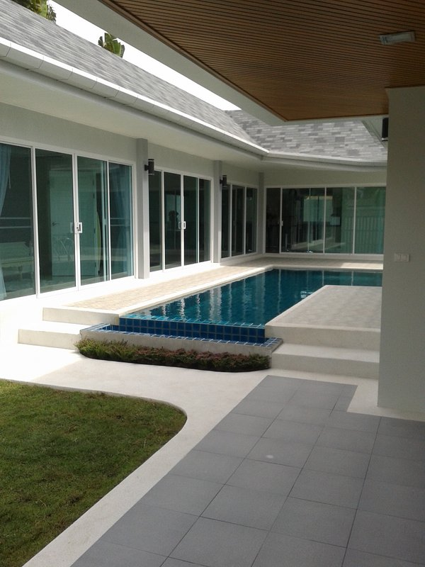 Modern Villa at the Nai Harn beach with pool and barbeque area. Large rooms with king-size beds.