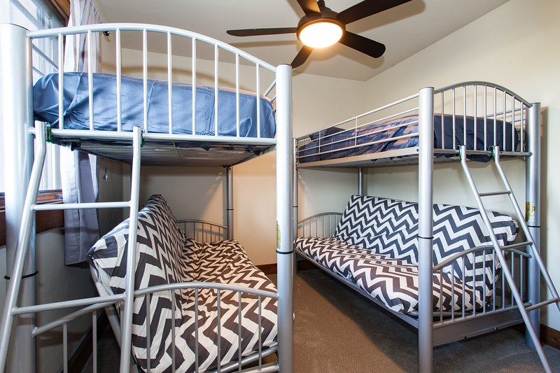 Bunk room with twins over full