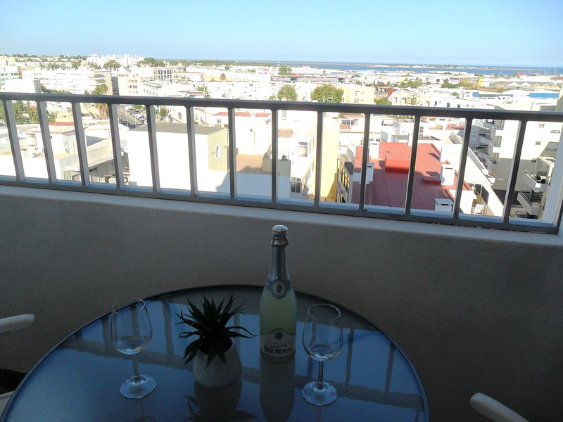 Balcony from kitchen with spectacular view looking to sea.