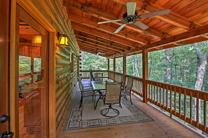 Enjoy the beautiful outdoors from furnished deck and front porch.