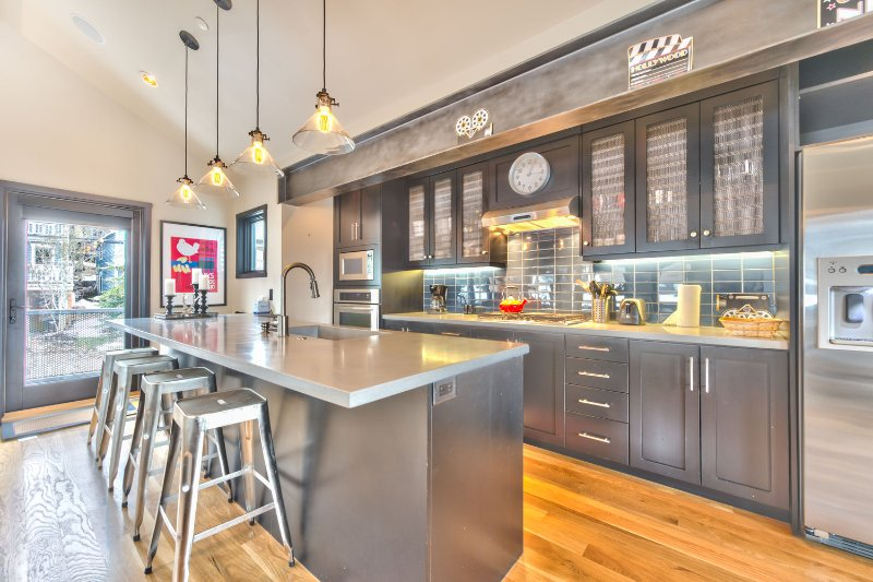 Newly Remodeled Gourmet Kitchen with Stainless Steel Appliances, Stone Counters, Bar Seating for 4