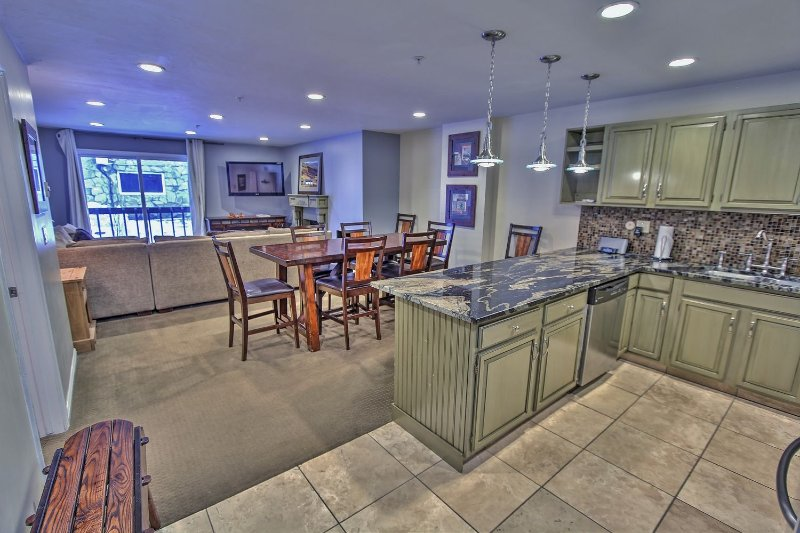 View of kitchen, dining area, & living room with fireplace and 47' HD TV/DVD with Wii & Xbox in Snowblaze 208 - Park City