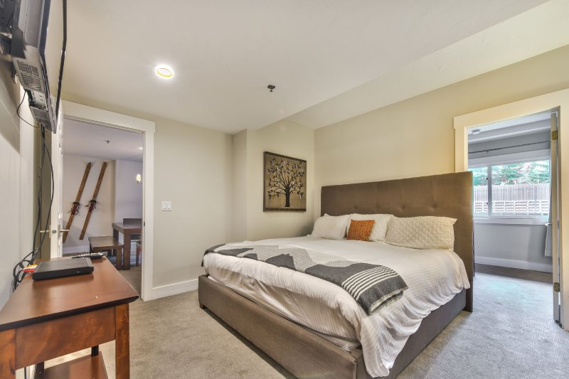 Master Bedroom with King Bed, 32' HD TV and Private Bath