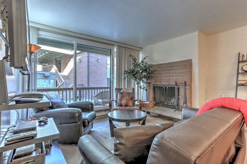 Living Room with TV, Fireplace and Patio Access