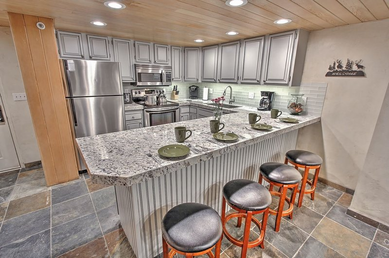 Newly Remodeled Kitchen with stainless appliances, full kitchen, Granite counters, and bar seating in Snowblaze 302 - Park City