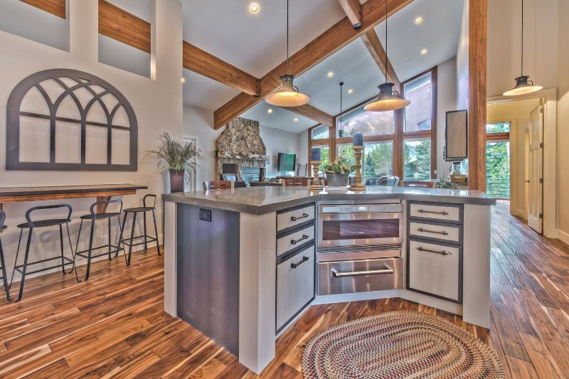 View of Kitchen Island with Microwave, Bar Seating for 3, Extra Seating at Island for 4