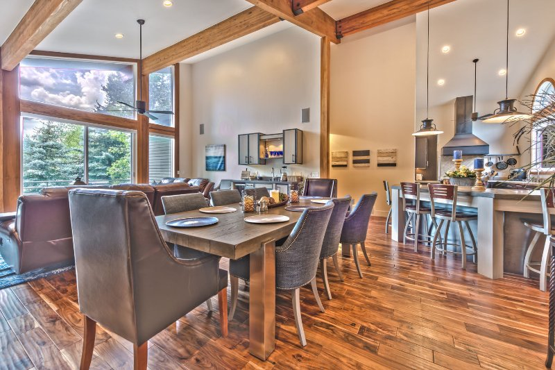 Spacious Great Room with the Gourmet Kitchen, Island and Bar Seating, Dining Area and Living Room with a Private Deck
