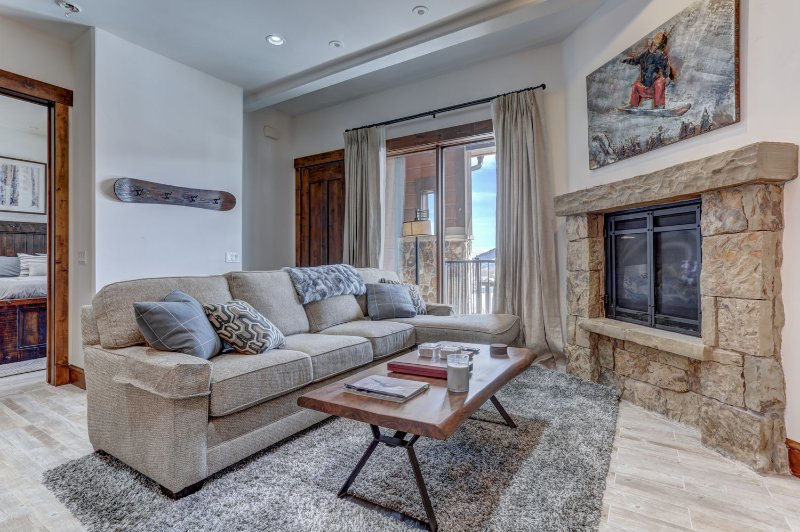 Living Room with Gas Fireplace, 55' Smart TV, Balcony Access