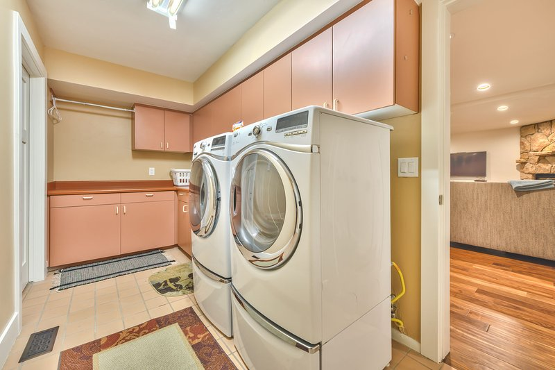 Laundry Room on Lower Level with Front Load Washer and Dryer
