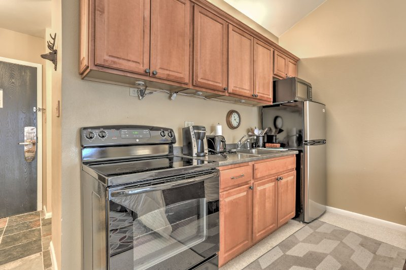 New Kitchen with Large Refrigerator, Stove/Oven, Microwave, Coffee Maker and Toaster