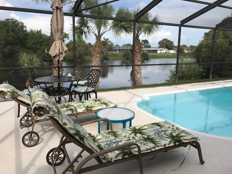 Enclosed Heated Pool with sitting/eating table and grill