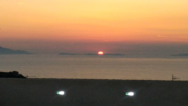 Sunset at roof shared terrace with ocean view and partial Capri Island view holidays up booking stay