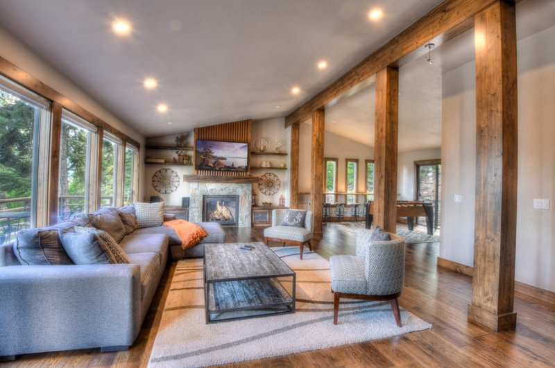 Spacious living room with large, open windows with a lot of natural light