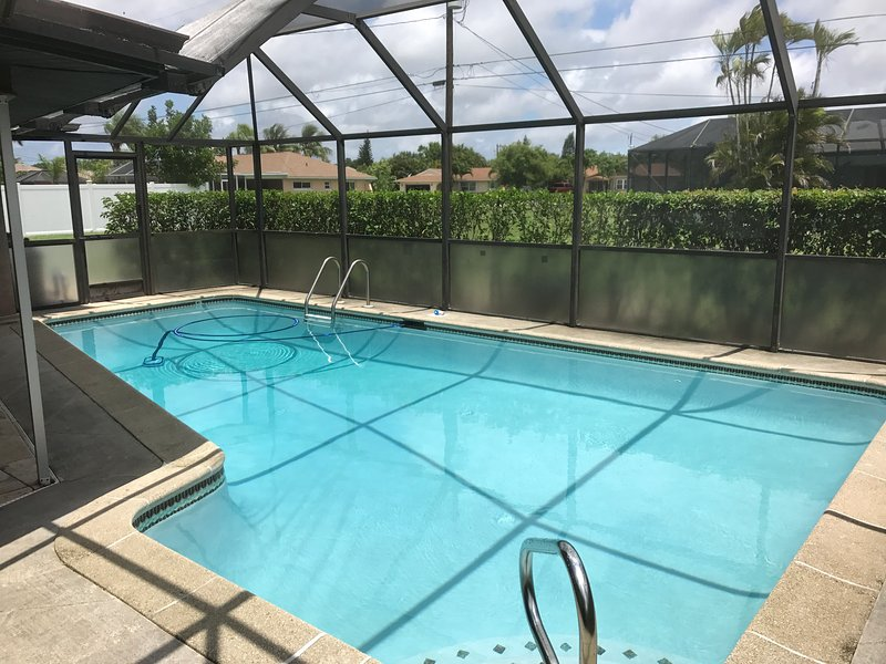 Screen enclosed large private pool with electric heat