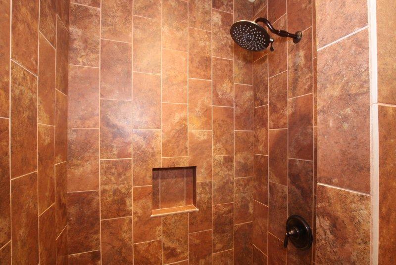 Amasing custom tile shower with rain shower head